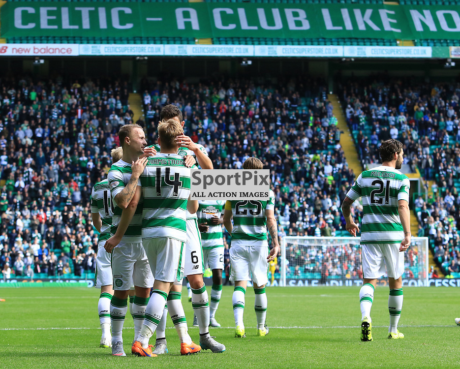 Celtic's Stuart Armstrong is mobbed by team-mates after scoring his second goal of  the Glasgow Celtic FC v Inverness Caledonian Thistle FC Scottish Premiership 15th August 2015 ©Edward Linton | SportPix.org.uk
