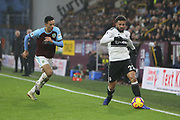 3 Charlie Taylor for Burnley FC chases Fulham defender Cyrus Christie (22) during the Premier League match between Burnley and Fulham at Turf Moor, Burnley, England on 12 January 2019.