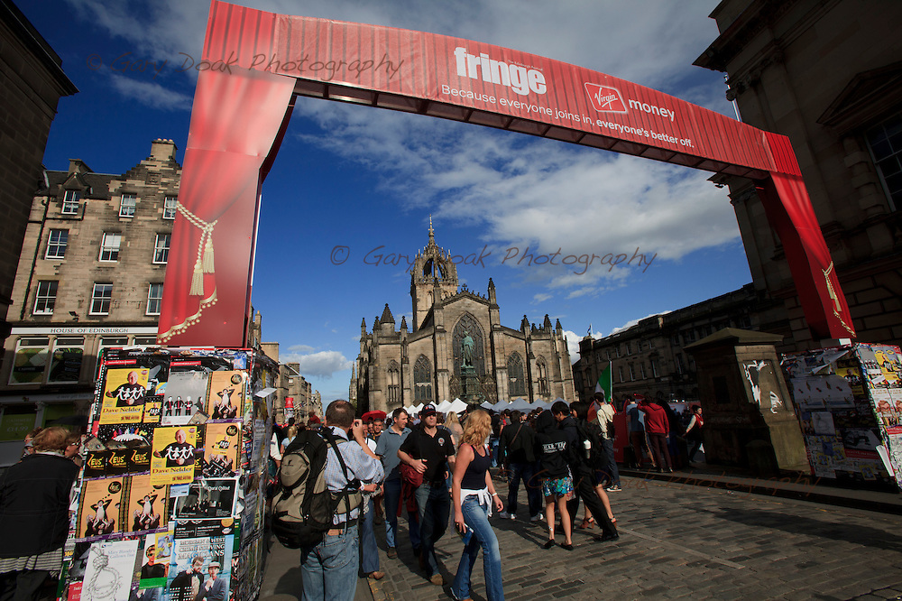 Fringe performers promote their shows on Edinburgh's Royal Mile, during the Edinburgh Festival