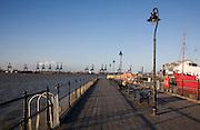 Person enjoying afternoon sunshine Ha'penny pier Harwich, Essex, England