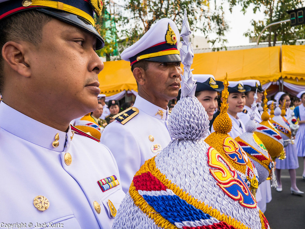 05 DECEMBER 2012 - BANGKOK, THAILAND:  Thai Army officers prepare to parade to the palace during the public ceremony to celebrate the birthday of Bhumibol Adulyadej, the King of Thailand, on Sanam Luang, a vast public space in front of the Grand Palace in Bangkok Wednesday night. The King celebrated his 85th birthday Wednesday and hundreds of thousands of Thais attended the day long celebration around the Grand Palace and the Royal Plaza, north of the Palace. The Thai monarch is revered by most Thais as unifying force in Thailand's society, which is not yet recovered from the political violence of 2010.     PHOTO BY JACK KURTZ