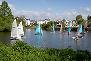 Local club members from the Twickenham Yacht Club gather at the start of a short boating competition on the River Thames near Ham, on 5th May 2019, in London, England.