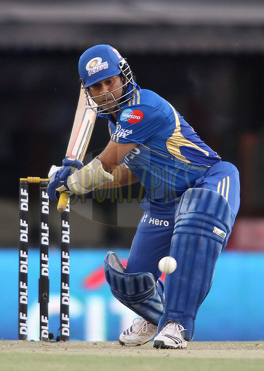 Sachin Tendulkar of the Mumbai Indians looks to attack a delivery during match 33 of the the Indian Premier League (IPL) 2012  between The Kings X1 Punjab and The Mumbai Indians held at the Punjab Cricket Association Stadium, Mohali on the 25th April 2012..Photo by Shaun Roy/IPL/SPORTZPICS