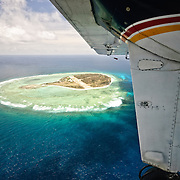 Aerial view of Lady Elliot Island from the window of the plane. Much of the island is surrounded by a lagoon.