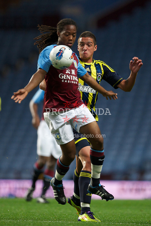 BIRMINGHAM, ENGLAND - Wednesday, September 28, 2011: Aston Villa's Daniel Johnson and Fenerbahce SK's Unal Noyan during the NextGen Series Group 3 match at Villa Park. (Pic by David Rawcliffe/Propaganda)