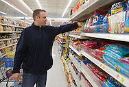 Nick Rhoades picks out snacks for a PITCH meeting at Walmart in Waterloo, Iowa on Thursday, November 7, 2013.