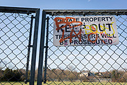 A 'Private Property Keep Out Trespassers Will Be Prosecuted' sign on a chain fence, in the borough of Southwark, on 24th February 2018, in south London, England.