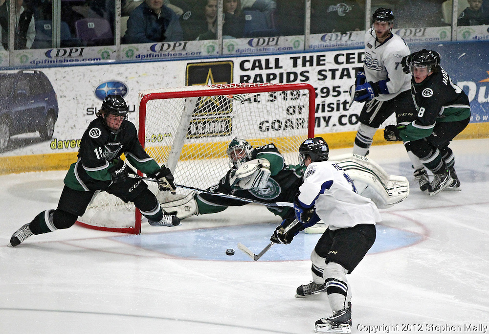 Roughriders' Dennis Kravchenko (18) and Matt McNeely (36) can't stop a goal by Force's Taylor Fleming (20) during their game at the Cedar Rapids Ice Arena, 1100 Rockford Road SW in Cedar Rapids on Saturday evening, February 18, 2012. (Stephen Mally/Freelance)