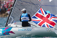ENGLAND, Weymouth. 5th August 2012. Olympic Games. Finn Class. Medal Race. Ben Ainslie (GBR) wins the gold medal, and becomes the most sucsessful Olympic sailor of all time. He has won four consecutive Gold medals: 2000 was a Laser class Gold and 2004, 2008and 2012 all came in the Finn class. He also took Silver at Savannah during the Atlanta Games in 1996.Paul Elvstrom (DEN) was the previous best. He also won 4 consecutive gold medals in Games 1948-1960 inclusive.