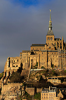 Mont San Michel lit up by late afternoon sun off the Normandy coast in France