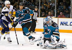 January 23, 2010; San Jose, CA, USA; San Jose Sharks goalie Evgeni Nabokov (20) makes a save in front of defenseman Rob Blake (4) and Buffalo Sabres center Tim Connolly (19) during the third period at HP Pavilion. San Jose defeated Buffalo 5-2. Mandatory Credit: Jason O. Watson / US PRESSWIRE