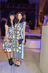 Left to right, MELISSA HEMSLEY and JASMINE HEMSLEY at a private view of Alexander McQueen's Savage Beauty exhibition hosted by Samsung BlueHouse at the V&A, London on 30th March 2015.