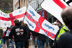 EDL members and supporters escorted by Police officers approach Rotherham Minster during Saturdays  EDL rally in South Yorkshire  in Rotherham Town Centre <br /> <br /> May 10 2014<br /> Image © Paul David Drabble <br /> www.pauldaviddrabble.co.uk