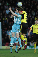 Photo: Richard Lane/Richard Lane Photography. Watford v Derby County. Coca Cola Championship. 12/12/2009. <br /> Stephen Pearson of Derby goes for a headerwith Watfords John Eustace