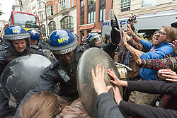 J11 protest.<br /> Police and protestors clash in Golden Square ,Soho, during the J11 protest in central London by the StopG8 anti-capitalist movement,<br /> London, United Kingdom<br /> Tuesday, 11th June 2013<br /> Picture by Mark  Chappell / i-Images