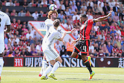 Marouane Fellaini Midfielder of Manchester United battles in the air and heads clear with Bournemouth Forward Callum Wilson during the Premier League match between Bournemouth and Manchester United at the Vitality Stadium, Bournemouth, England on 14 August 2016. Photo by Phil Duncan.
