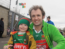 Jack Coyne aged 3 with dad Robert at McHale park for the Mayo v Kerry national football league encounter. Pic Conor McKeown