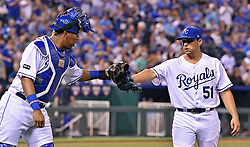 April 13, 2017 - Kansas City, MO, USA - Kansas City Royals starting pitcher Jason Vargas is congratulated by catcher Salvador Perez after Vargas initiated a double play to end the top of the seventh inning against the Oakland Athletics at Kauffman Stadium in Kansas City, Mo., on Thursday, April 13, 2017. (Credit Image: © John Sleezer/TNS via ZUMA Wire)