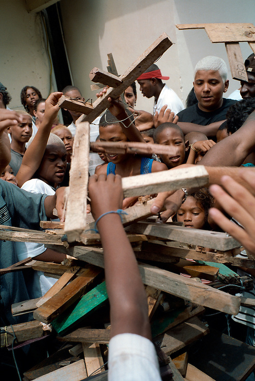 An anti-gun campaign in the favela organised by Afro Reggae. Children are asked to hand in their toy guns in exchange for other toys. Rio de Janerio, Brazil. 2001