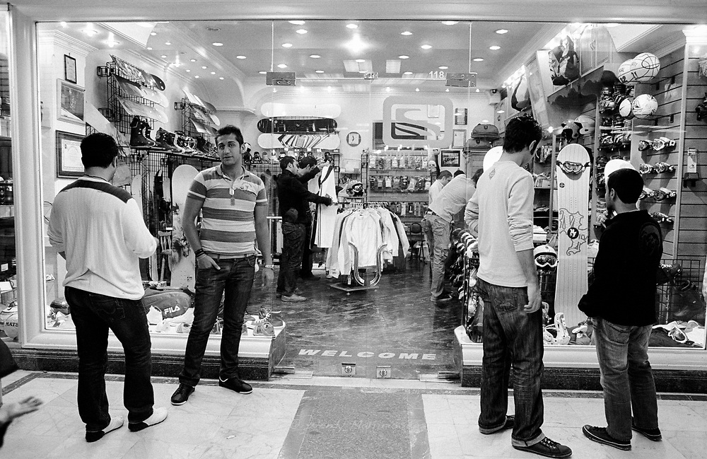 Young Iranian men standing in front of a wintersport shop in a local shoppingmall. Tehran, Iran, 2007