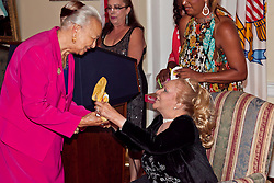 Queen Carmen Nicholson Sibilly, 1952 receives the first gift from Mrs. Leah Sasso McAllister