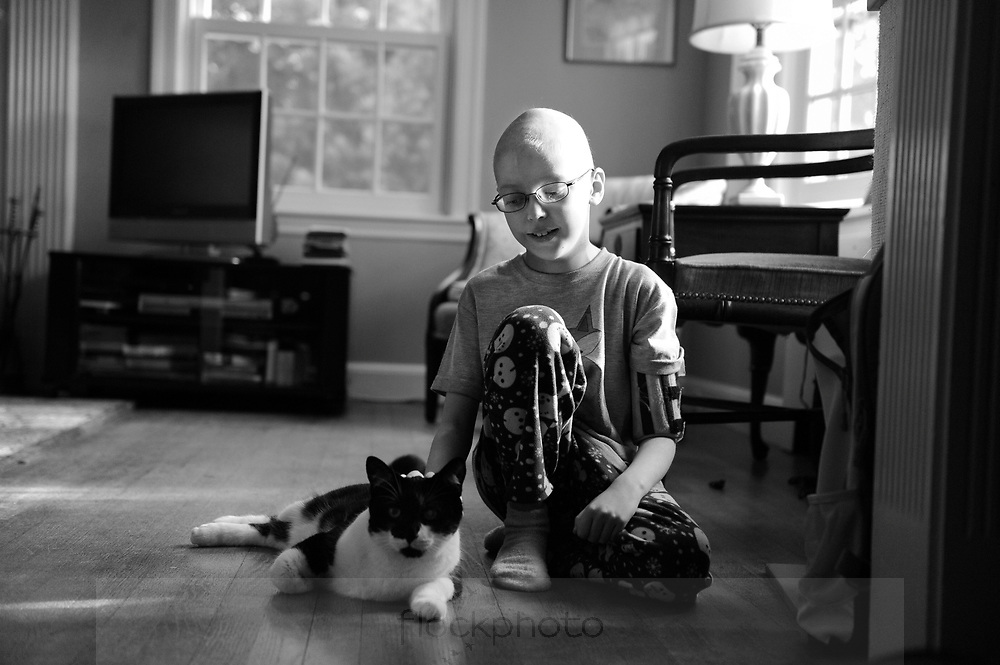 Alice Meacci plays with her cat, Bucky, at home in Newton, Wednesday, Dec. 16, 2015.<br /> Wicked Local staff photo / Kate Flock