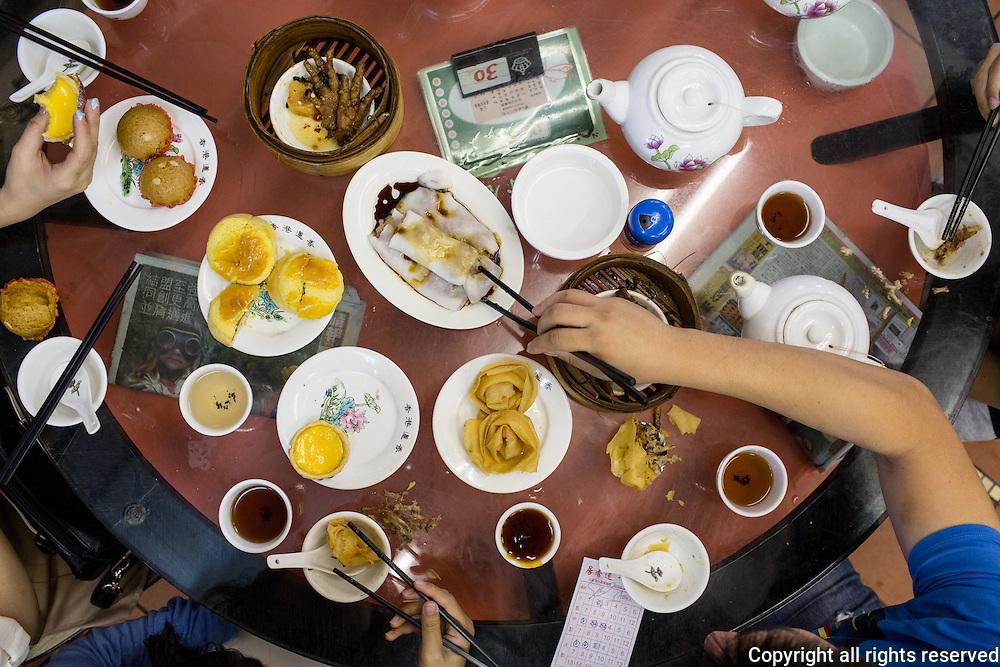 Dim Sum in Hong Kong. Egg tarts, chee cheong fun (rice flour sheets filled ith minced barbeque pork), stewed chicken feet, crisp fried dumplings