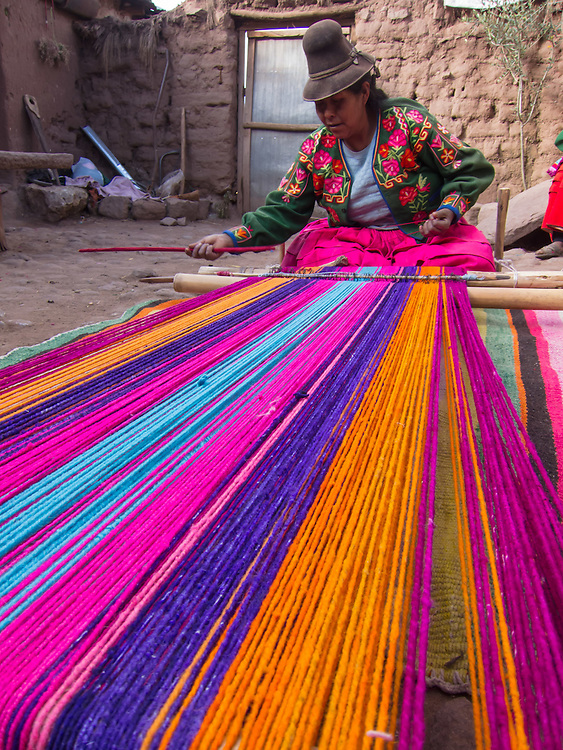 Aymara woman weaving on traditional loom, Lake Titicaca, Puno area, Peru, South America