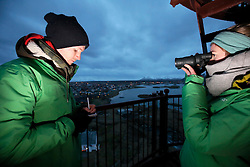 NORWAY ANDENES 8DEC15 - Greenpeace campaigners Larissa Baeumer of Germany and Erlend Tellnes (L) of Norway during whale spotting from the lighthouse on the coast at Andenes, Norway.<br /> <br /> jre/Photo by Jiri Rezac / Greenpeace<br /> <br /> © Jiri Rezac 2015