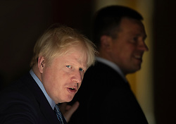 © Licensed to London News Pictures. 06/08/2019. London, UK. Prime Minister Boris Johnson looks round as he meets with Prime Minister of Estonia, Jüri Ratas (R) on the doorstep of 10 Downing Street. Photo credit: Peter Macdiarmid/LNP