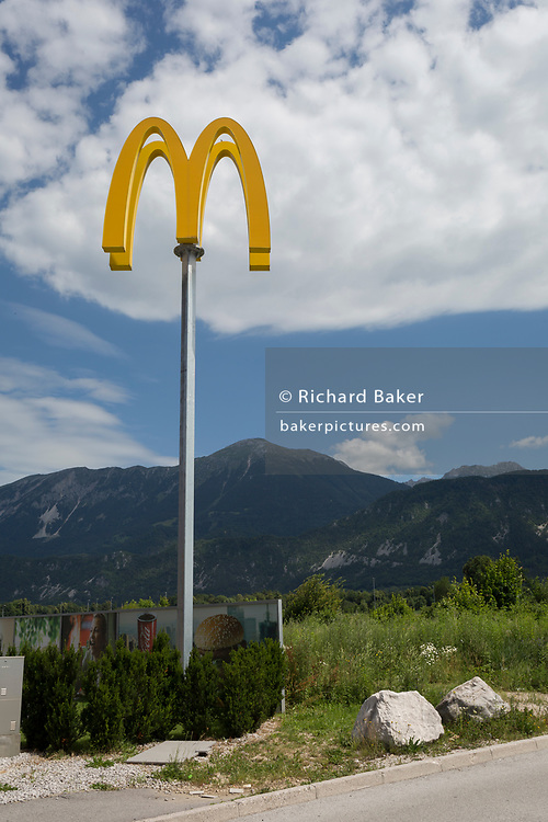 A landscape of a McDonalds logo on the outskirts of a rural Slovenian town, on 18th June 2018, in Bled, Slovenia.