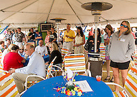 Local business people and friends came to the Naswa Beach Bar Monday afternoon to celebrate along with the Makris family the 80th birthday of the Naswa Resort.  (Karen Bobotas/for the Laconia Daily Sun)