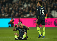 Football - 2018 / 2019 Premier League - West Ham United vs. Manchester City<br /> <br /> Sergio Aguero (Manchester City) sits on the floor frustrated after his shot is blocked at the London Stadium<br /> <br /> COLORSPORT/DANIEL BEARHAM
