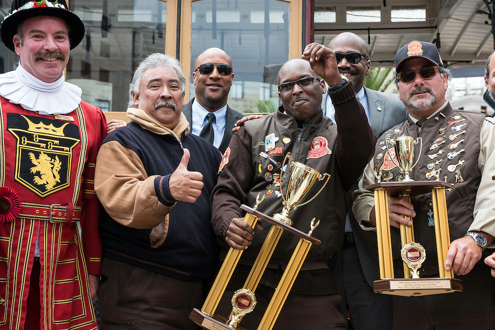 (l to r) Beefeater Tom Sweeney of the Sir Francis Drake Hotel, Cable Car Division Union Chair TWU Local 250A Antonio Gonzalaz, TWU Local 250A Union Treasurer Bernard Broughton, 2013 World Champion Bell Ringer Trini Whittaker, TWU Local 250A Union Executive Vice President Ron Austin and 2013 2nd place Bell Ringer Ken Lunardi at the 50th Cable Car Bell Ringing Competition in San Francisco's Union Square | July 11, 2013