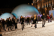 December 21st 2005. Hotel de Ville (City Hall). Paris, France..People enjoy the ice skating rink in front of City Hall.