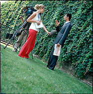 UK. London. From a story on Abingdon Street Gardens, a small patch of land, often referred to as College Green, that lies next to The Houses of Parliament in Westminster. It is a place where the media and the politicians come face to face. Interviews are held, photo shoots are set up and bewildered tourists stroll by..Photo shows a spokesman for The British Muslim Association discussing the July bombs in London..Photo©Steve Forrest/Workers Photos