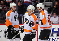 Dec. 3 2011; Glendale, AZ, USA; Philadelphia Flyers forward Claude Giroux (28), Sean Couturier (14) and Maxime Talbot (27) talk on the ice while playing against the Phoenix Coyotes during the first period at Jobing.com Arena. Mandatory Credit: Jennifer Stewart-US PRESSWIRE.