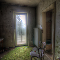 Old very moldy hotel.<br /> Hotel Schimmelig. Interior with chair