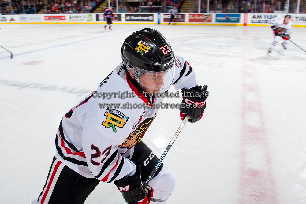 KELOWNA, CANADA - OCTOBER 21: Ilijah Colina #23 of the Portland Winterhawks skates along the boards to block the pass against the Kelowna Rockets on October 21, 2017 at Prospera Place in Kelowna, British Columbia, Canada.  (Photo by Marissa Baecker/Shoot the Breeze)  *** Local Caption ***