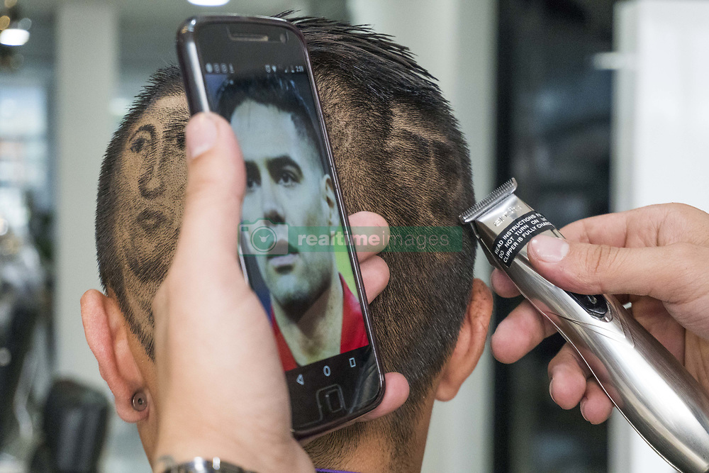 June 14, 2018 - Bogota, Colombia - Barber Mike Rivera sculpts football players like Ronaldo, James, Falcao, Juan Guillermo Cuadrado, Messi, among others, in the hair on heads of his clients. (Credit Image: © Daniel Garzon Herazo via ZUMA Wire)