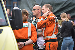 © Licensed to London News Pictures. 15/08/2019. London, UK. Helicopter Emergency Medical Services (HEMS) doctor covered in engine oil at Clapham North Station, where emergency services responded to an incident involving a who man reportedly took his life in front of his family, jumping onto the tracks as a train pulled into the platform. Attending HEMS Air Ambulance, fire crews and paramedics were unable to save the man. Photo credit: Guilhem Baker/LNP