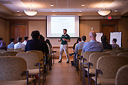 Dr. Sinan Gokkaya, Assistant Professor of Finance at Ohio University's College of Business, speaks with attendees during his lecture session at Baker Center on Saturday, August 27, 2016.