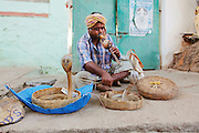 A snake charmer sits in Hampi Bazaar. Founded in 1336, Vijayanagar was the capital of an alliance of southern Hindu kingdoms that ruled southern India for hundreds of years and left a sprawling architectural wonderland of magnificent temple ruins set amongst an otherworldly landscape of gigantic sandstone boulders, meandering streams and banana plantation near the village of Hampi in the state of Karnataka. The temples, spread over an area of 25 square kilometers and 58 of its 550 buildings were declared UNESCO World Heritage Sites in 1986. Other than the Taj Mahal, no other monument in India is written about as much as Hampi. But the millions of visitors who visit those other architectural sites have yet to show serious interest in Hampi, which is remote, lacks infrastructure and is hardly publicized.