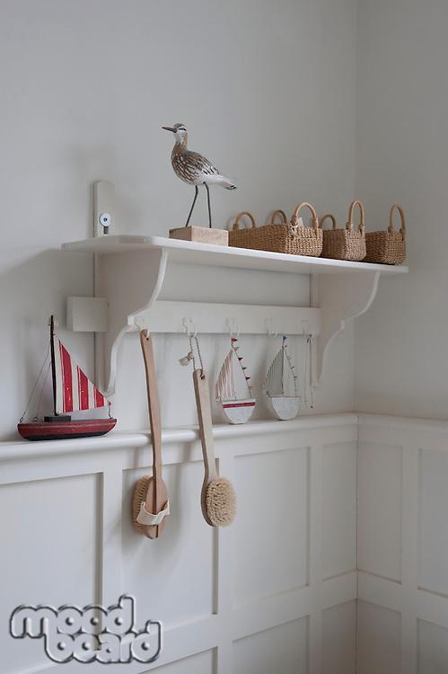 Bird statue and baskets on bathroom shelf London