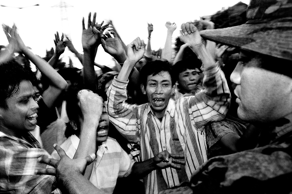 Anti-Golkar party rioters clash with military in Jakarta during the June 1999 elections.