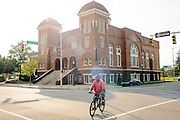 A man rides his bike in front of 16th Street Baptist Church in downtown Birmingham, Alabama. In 1963, four girls were killed when a bomb under the church's side steps went off.