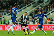 Miguel Almiron (#24) of Newcastle United evades the challenge of Mason Mount (#19) of Chelsea during the Premier League match between Newcastle United and Chelsea at St. James's Park, Newcastle, England on 18 January 2020.