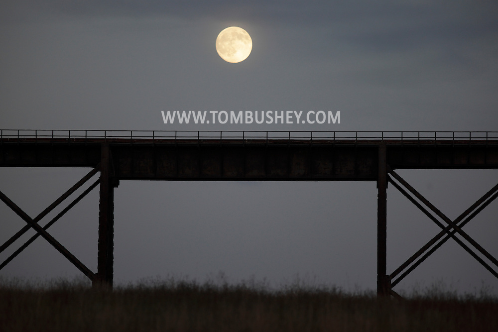 Salisbury Mills, New York - The nearly full moon rises above the Moodna Viaduct railroad trestle on Nov. 20, 2010.