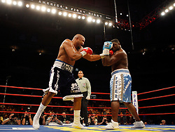 October 6, 2007; New York, NY, USA; WBC heavyweight champion Samuel Peter ( )and Jameel McCline ( ) trade punches during their 12 round bout at Madison Square Garden in New York.