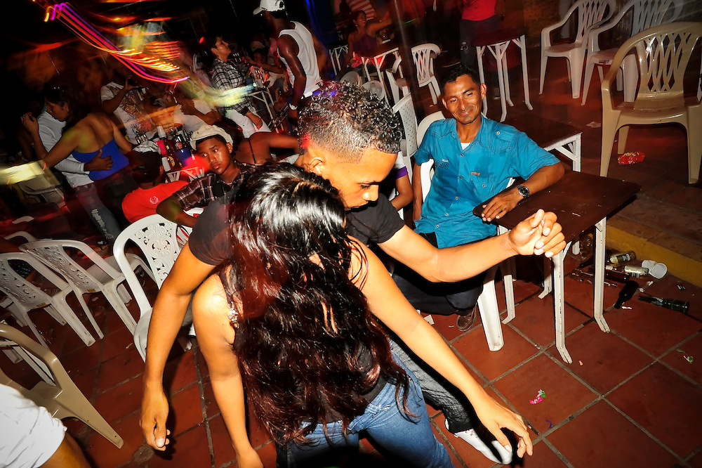 Men and women dance in a discotec in the Los Ejecutivos area of Cartagena, Colombia. This coastal city boasts many bars and discotecs where foreign tourists can drink, dance, and pick up prostitutes. A sex scandal erupted recently when secret service agents were found bringing prostitutes to their hotel rooms while in Cartagena preparing for President Barack Obama's arrival to the Summit of the Americas.